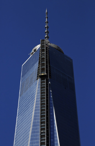 A partial view of One World Trade Center, a skyscraper built at the site of the 9/11 attacks on the World Trade Center in New York. (AP Photo/Lefteris Pitarakis)