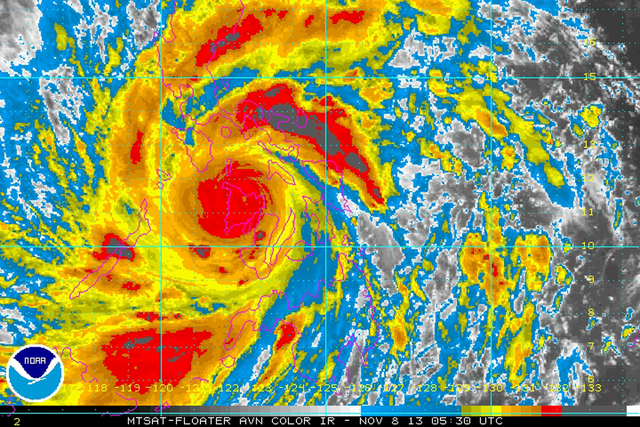 In this image provided by NOAA Friday Nov. 8, 2013 which was taken at 12:30 a.m. EST shows Typhoon Haiyan as it crosses the Philippines. One of the most powerful typhoons ever recorded slammed int ...