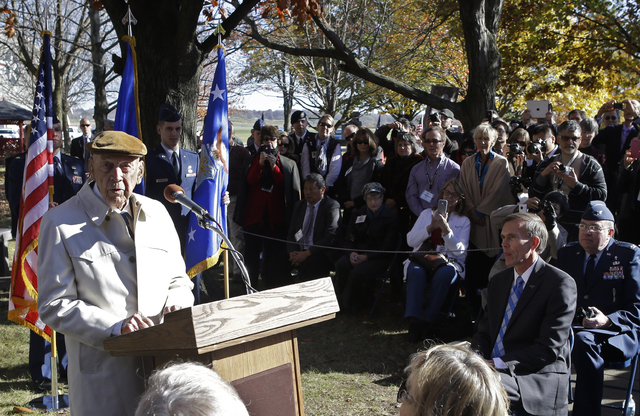 Richard Cole, left, one of the four surviving members of the 1942 raid on Tokyo led by Lt. Col. Jimmy Doolittle, speaks for the other survivors during ceremonies honoring them, Saturday, Nov. 9, 2 ...