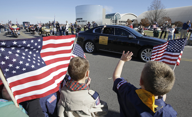 David Thatcher, one of the four surviving members of the 1942 raid on Tokyo led by Lt. Col. Jimmy Doolittle, waves from a car as he arrives at the National Museum of the US Air Force, Saturday, No ...