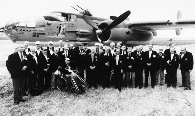 FILE - In this April 17, 1987 file photo, thirty members of Jimmy Doolittles Tokyo Raiders pose for a group picture in front of a B-25J bomber in Torrance, Calif.,  as they gather for a reunion.   ...