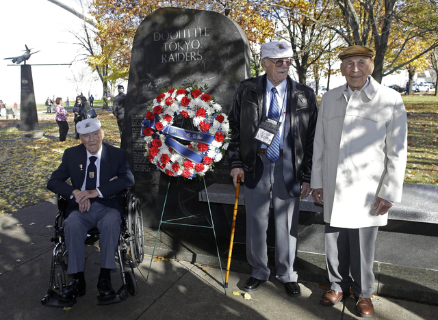 Three of the four surviving members of the 1942 Tokyo raid led by Lt. Col. Jimmy Doolittle, left to right, David Thatcher, Edward Saylor, and Richard Cole, pose next to a monument marking the raid ...