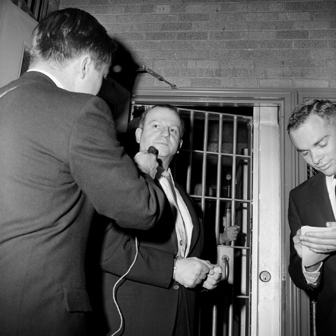 In this Jan. 28, 1964 file photo, Jack Ruby talks to a reporter while being returned to jail after a psychiatric examination in Dallas. As Lee Harvey Oswald was being transferred from police headq ...