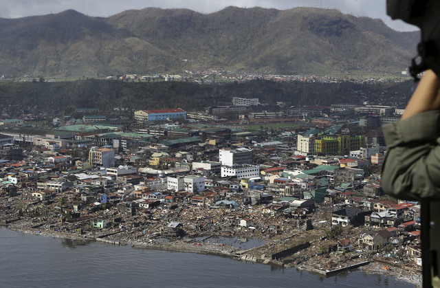 The devastation caused by Typhoon Haiyan, are seen Sunday, Nov. 10, 2013, in Tacloban city, Leyte province in central Philippines. Typhoon Haiyan, one of the most powerful storms on record, slamme ...