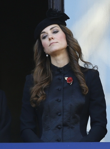 Britain's Duchess of Cambridge Kate Middleton listens from a balcony during the service of remembrance at the Cenotaph in Whitehall, London, Sunday, Nov. 10, 2013. The annual remembrance service i ...