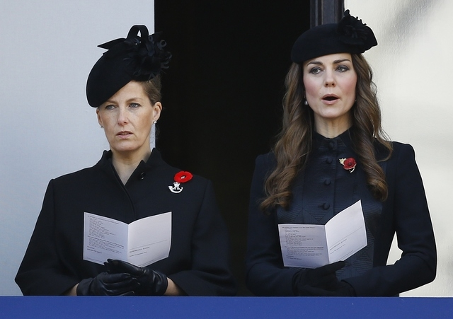 Britain's Kate, the Duchess of Cambridge, right, and Sophie, the Countess of Wessex sing from a balcony during the service of remembrance at the Cenotaph in Whitehall, London, Sunday, Nov. 10, 201 ...