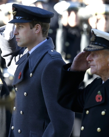 Britain's Prince William, left, and Prince Philip salute during the service of remembrance at the Cenotaph in Whitehall, London, Sunday, Nov. 10, 2013. The annual remembrance service is to remembe ...