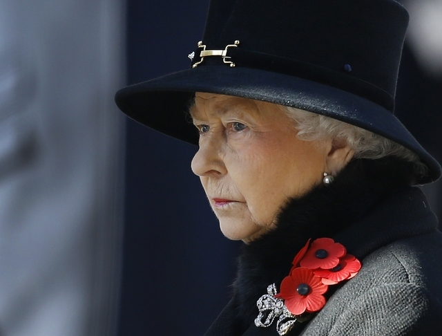 Britain's Queen Elizabeth II listens during the service of remembrance at the Cenotaph in Whitehall, London, Sunday, Nov. 10, 2013. The annual remembrance service is to remember those who have los ...