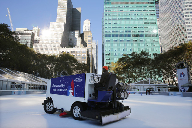 The ice rink at Bryant Park in New York is resurfaced on Sunday, Nov. 10, 2013. A shooting at the ice rink at the popular midtown Manhattan park late Saturday sent two men to the hospital with non ...
