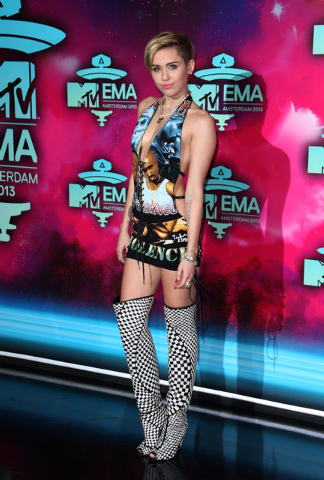 Miley Cyrus poses for photographers upon arrival at the 2013 MTV Europe Music Awards, in Amsterdam, Netherlands, Sunday, Nov. 10, 2013. (Photo by Joel Ryan/Invision/AP)