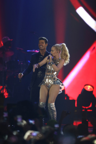 Robin Thicke, left, and Iggy Azalea, right,  perform at the 2013 MTV Europe Music Awards in Amsterdam, Netherlands, Sunday, Nov. 10, 2013. (AP Photo/Peter Dejong)