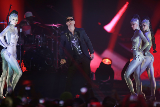 Robin Thicke performs at the 2013 MTV Europe Music Awards in Amsterdam, Netherlands, Sunday, Nov. 10, 2013. (AP Photo/Peter Dejong)