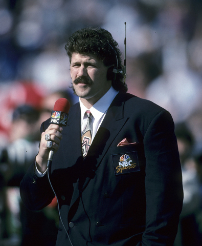 This Jan. 31, 1993, photo provided by the NFL shows NBC sideline reporter and former player Todd Christensen doing a segment from Super Bowl XXVII, between the Dallas Cowboys and Buffalo Bills, at ...