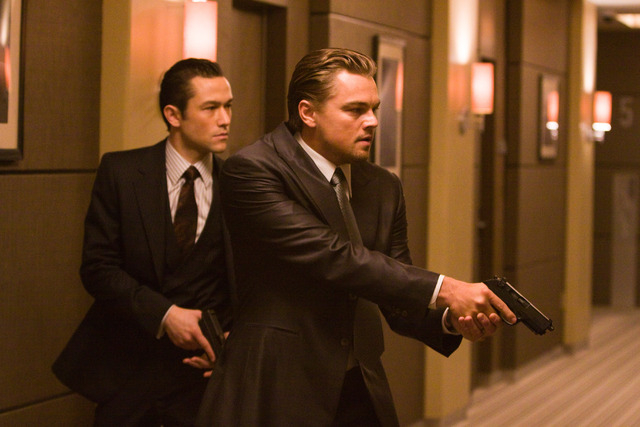 """In this film publicity image released by Warner Bros., Joseph Gordon Levitt, left, and Leonardo DiCaprio are shown in a scene from """"Inception.""""  Gun violence in PG-13 rated movies has in ..."""