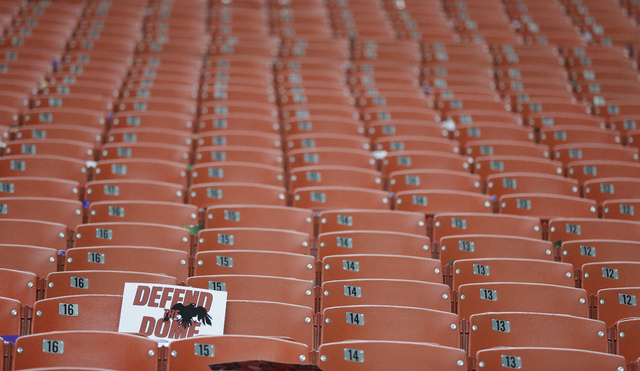 A Falcons placard sits alone at the Georgia Dome on Sept. 29 after Atlanta's 30-23 loss to the Patriots. Though television ratings stay strong, the number of people showing up at NFL games is dw ...