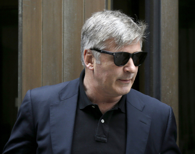 Actor Alec Baldwin leaves criminal court in New York, Tuesday, Nov. 12, 2013. Baldwin testified Tuesday that he never had a sexual or romantic relationship with Canadian actress Genevieve Sabourin ...