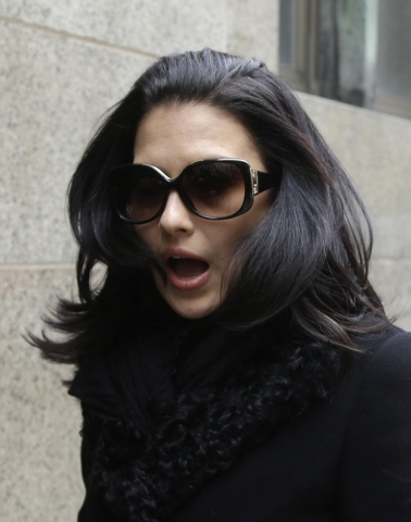 Hilaria Baldwin, wife of actor Alec Baldwin, arrives to court in New York, Tuesday, Nov. 12, 2013. Alec Baldwin testified Tuesday that he never had a sexual or romantic relationship with a Canadia ...