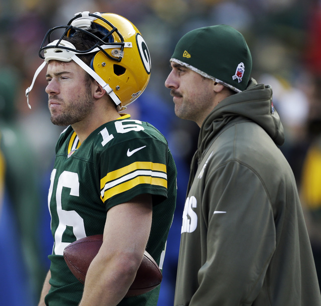 Green Bay Packers' Aaron Rodgers and Scott Tolzien watch from the sidelines during the second half of an NFL football game against the Philadelphia Eagles Sunday, Nov. 10, 2013, in Green Bay, Wis. ...