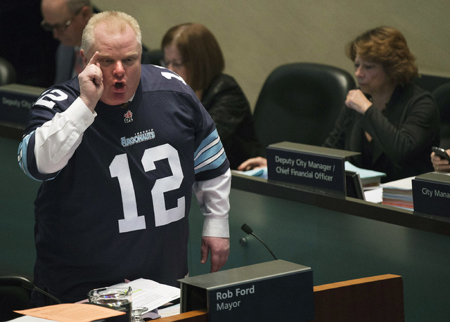 Mayor Rob Ford speaks to city council members about new allegations against him in Toronto on Thursday, Nov. 14, 2013. (AP Photo/The Canadian Press, Nathan Denette)