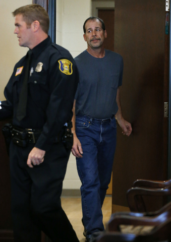 Theodore P. Wafer, 54, of Dearborn Heights, appears at his arraignment in 20th District Court in Deaborn Heights, Mich., Friday, Nov. 15, 2013. Wafer faces second-degree murder and manslaughter ch ...