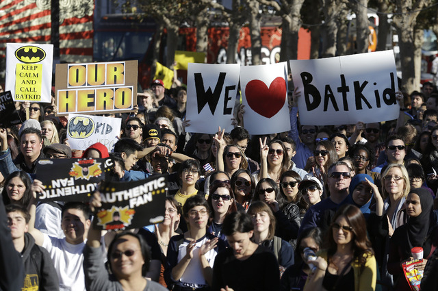 A crowd holds up signs for Miles Scott, as Batkid, at a rally outside of City Hall in San Francisco, Friday, Nov. 15, 2013.  (AP Photo/Jeff Chiu)