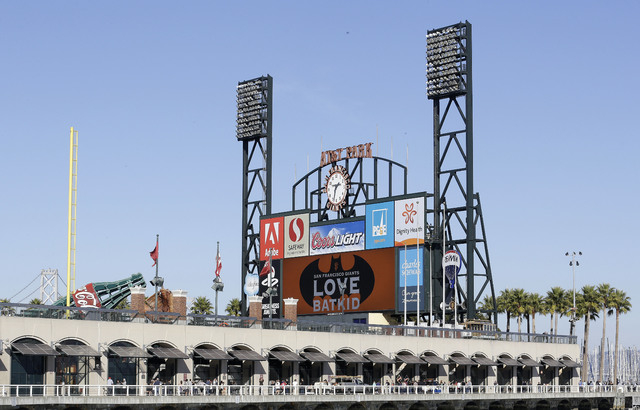 The scoreboard at AT&T Park displays a sign for Miles Scott, as Batkid, in San Francisco, Friday, Nov. 15, 2013. (AP Photo/Jeff Chiu)