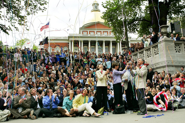 In this May 17, 2005 file photo, hundreds of gay couples and supporters look up while streamers fall at the conclusion of a group photo in front of the Statehouse in Boston, one year after Massach ...