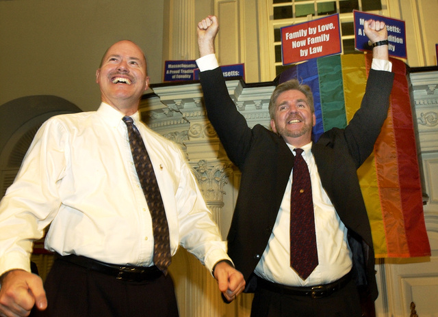 In this Nov. 18, 2003 file photo, Ed Balmelli, left, and Michael Horgan of Boston, one of seven gay couples who sued the state of Massachusetts, celebrate during a rally at the Old South Meeting H ...