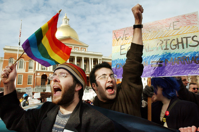 In this March 11, 2004 file photo, James Jenner, of Boston, left, and James Murphy, of Cambridge, Mass. show their support for same-sex marriage in front of the Statehouse in Boston. Several thous ...