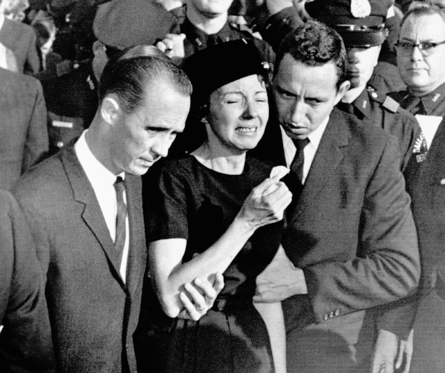 FILE - In this Monday, Nov. 25, 1963 file photo, Marie Tippit, widow of police officer J.D. Tippit who was slain during the search for President John F. Kennedy's assassin, is led weeping from Bec ...