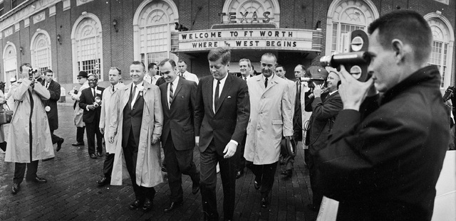FILE - In this Friday morning, Nov. 22, 1963 file photo, President John F. Kennedy, center, and Vice President Lyndon Johnson, center right, walk with others in downtown Fort Worth, Texas. Later i ...