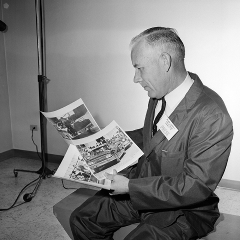 "FILE - In this Dec. 3, 1963 file photo, James W. ""Ike"" Altgens, Associated Press Wirephoto operator-photographer, holds prints of the photographs he made of the Friday, Nov. 22, 1963 ass ..."