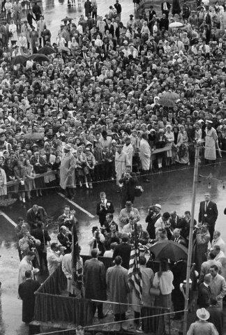 FILE - In this Nov. 22, 1963 file photo, President John F. Kennedy, center on foreground platform, addresses a rain-soaked crowd in Fort Worth, Texas. In an interview, Secret Service agent Clint H ...