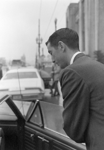 FILE - In this Feb. 14, 1969 file photo, Buell Wesley Frazier of Irving, Texas, a co-worker of Lee Harvey Oswald at the Texas School Book Depository in Dallas, leaves court after testifying in the ...