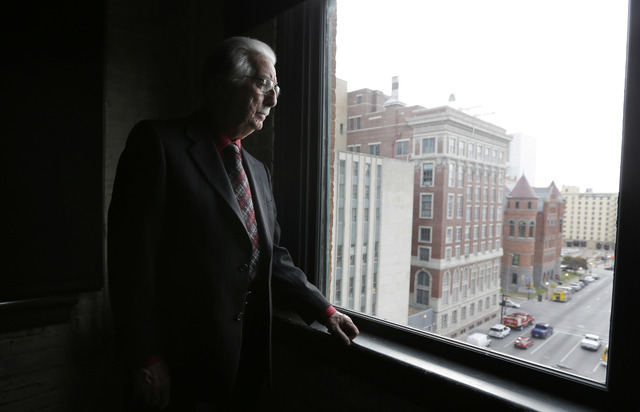 Buell Wesley Frazier looks out onto Dealey Plaza from a window on the seventh floor of the Texas School Book Depository building in Dallas on Thursday, Nov. 14, 2013. Frazier was a co-worker of Le ...