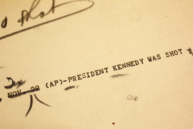 This Thursday, Oct. 31, 2013 photo of an Associated Press teletype news bulletin from Friday, Nov. 22, 1963 shows early news that President Kennedy had been shot in Dallas, in the AP Corporate Arc ...