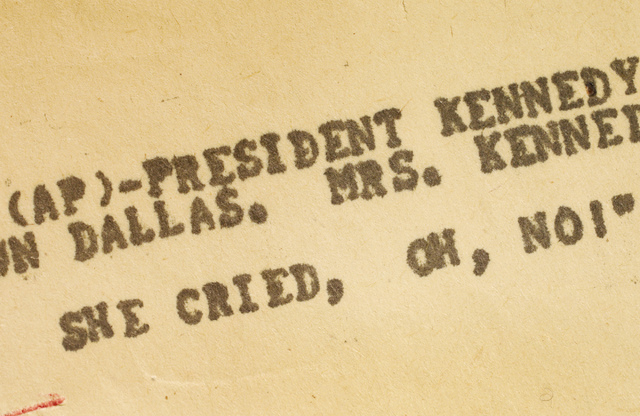 This Thursday, Oct. 31, 2013 photo of an Associated Press teletype news bulletin from Friday, Nov. 22, 1963 shows early news that President Kennedy had been shot in Dallas. The document is kept in ...