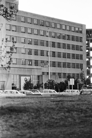 FILE - In this Friday, Nov. 22, 1963 file photo, a U.S. flag flies at half-staff in front of Parkland Memorial Hospital in Dallas where President John F. Kennedy was declared dead after being shot ...