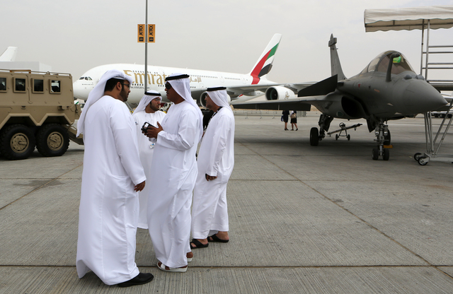 Emirati visitors talk in front of an Emirates Airbus A380 on display during the opening day of the Dubai Airshow in Dubai, United Arab Emirates, Sunday Nov. 17, 2013. The Dubai Airshow is seen as  ...