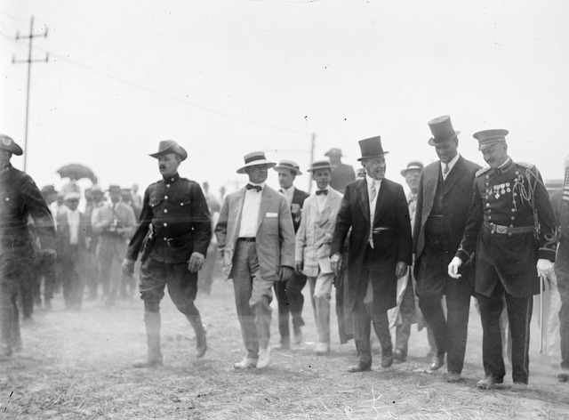 In this July 1913 photo made available by the Library of Congress, President Woodrow Wilson, third from right, attends a commemoration for the 50th anniversary of the Battle of Gettysburg. After A ...