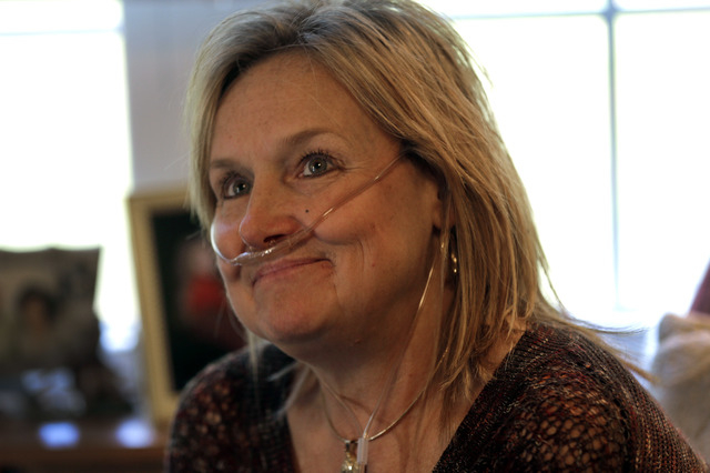 Lisa Bowman sits at her home in Union Grove, N.C. Bowman, who suffers from a lung disease, has been on the transplant waiting list for two years. It's a little-known twist of nature: Your lungs ca ...