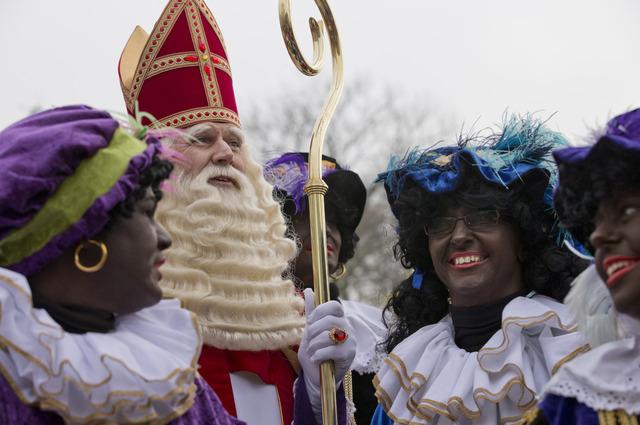 """The Dutch version of Santa Claus, Sinterklaas, or Saint Nicholas, and his blackface sidekicks """"Zwarte Piet"""" or """"Black Pete"""" arrive by steamboat in Hoorn, north-western Netherla ..."""