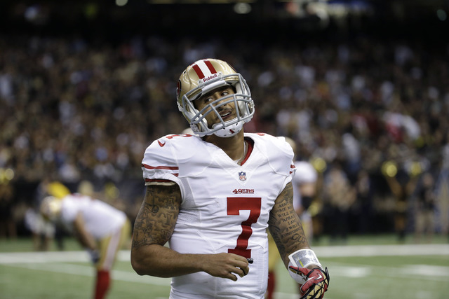 San Francisco 49ers quarterback Colin Kaepernick (7) reacts in the second half of an NFL football game against the New Orleans Saints in New Orleans, Sunday, Nov. 17, 2013. The Saints won 23-20. ( ...