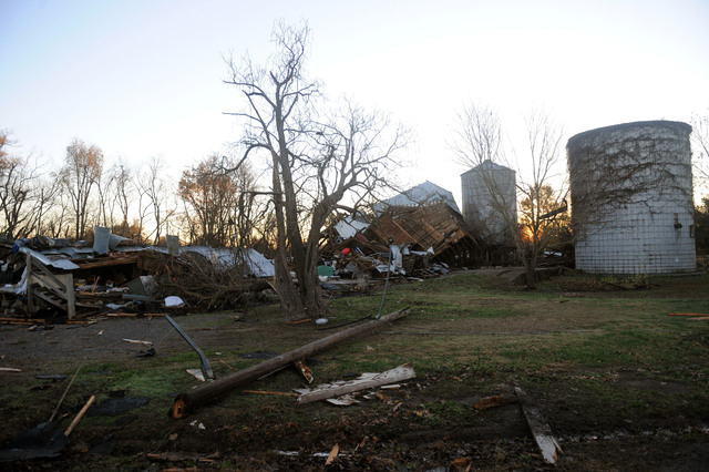 Debris lies on the ground in Brookport, Ill., Monday, Nov. 18, 2013, after a tornado moved through the area. An unusually large and strong late-season storm system ripped through several states ac ...