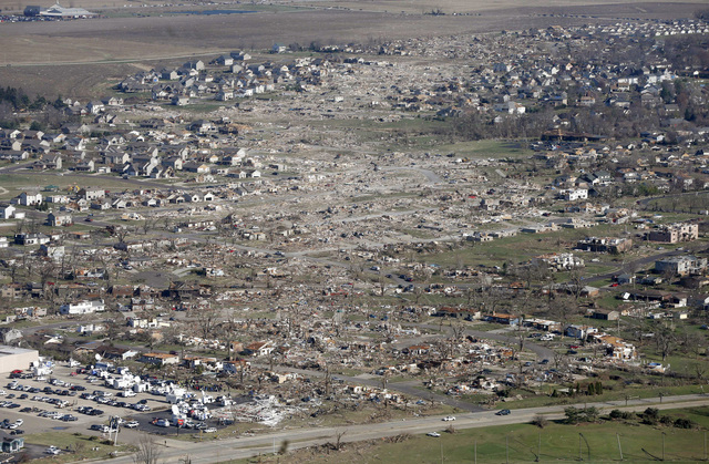 This aerial view on Monday, Nov. 18, 2013, shows the path of a tornado that hit the western Illinois town of Washington on Sunday. It was one of the worst-hit areas after intense storms and tornad ...