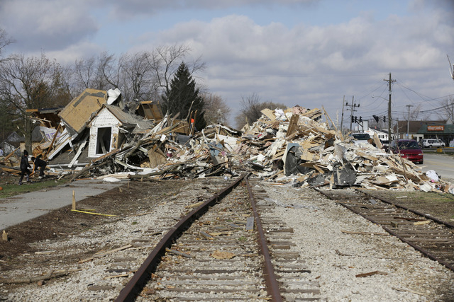 The home of Phyllis Rawlins sits on an adjacent rail road track after being destroyed by a tornado in Kokomo, Ind., Monday, Nov. 18, 2013.  Sunday's storm picked up Rawlins' Victorian-style house  ...
