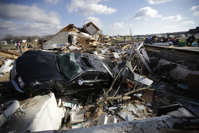 The home of Phyllis Rawlins is destroyed home in Kokomo, Ind., Monday, Nov. 18, 2013.  Sunday's storm picked up Rawlins' Victorian-style house and moved it about 100 feet, leaving a 15-foot pile o ...