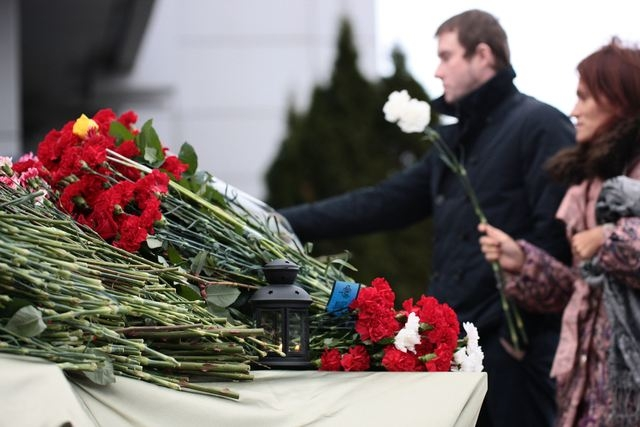 People place flowers in Kazan airport Monday, Nov. 18, 2013. A plane belonging to Tatarstan Airlines crashed Sunday while trying to land at its home port in the Russian city of Kazan, the capital  ...