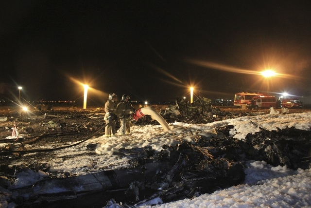 In this photo taken on Sunday, Nov. 17, 2013 and provided by Russian Emergency Situations Ministry fire fighters and rescuers work at the crash site of a Russian passenger airliner near Kazan, the ...