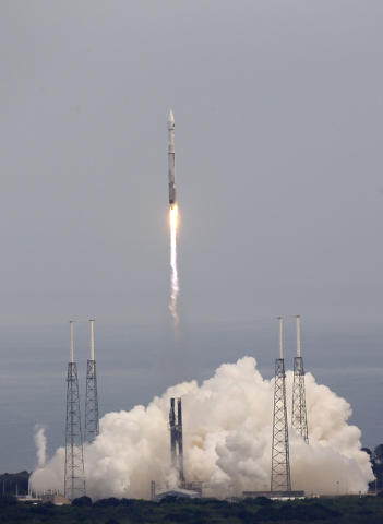 NASA's newest robotic explorer, Maven, atop a United Launch Alliance Atlas 5 rocket, lifts off from Cape Canaveral Air Force Station, Monday, Nov. 18, 2013, in Cape Canaveral, Fla. The spacecraft  ...